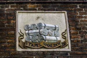 Le formelle sulla facciata delle case indicavano l'attività del proprietario